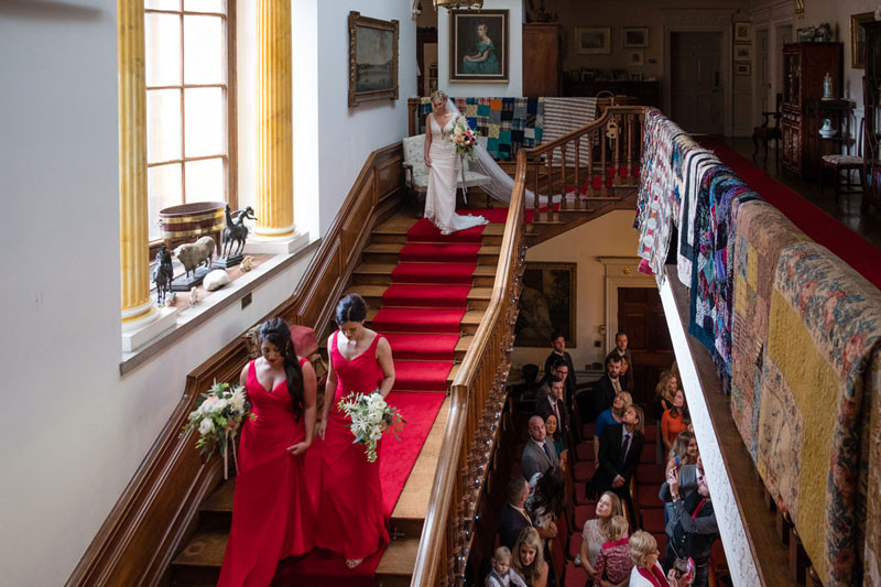 Bride on the staircase at Walcot Hall