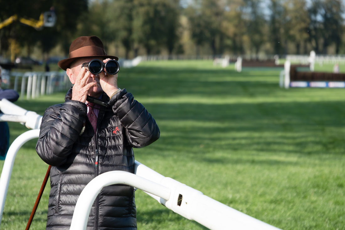 Racing spectator with binoculars