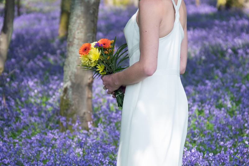 Bride with bouquet in bluebells