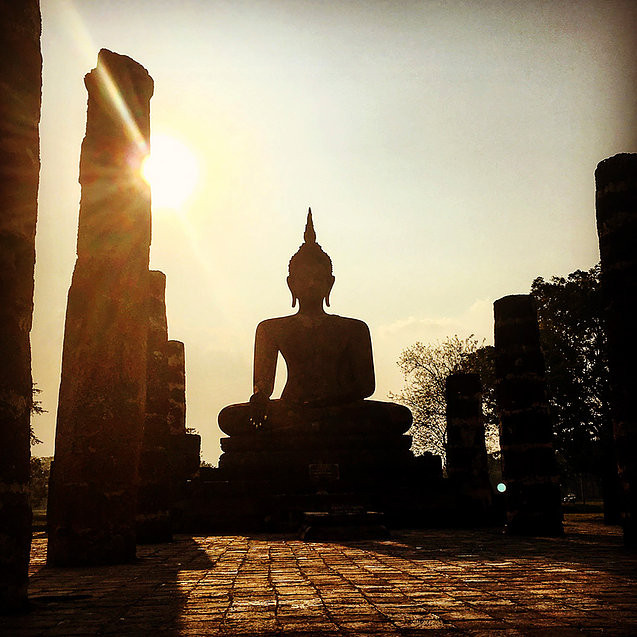 A buddha at sunset at Sukhothai