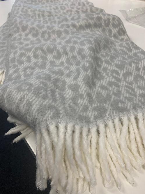 Leopard print fringe plush throw