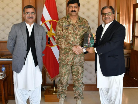 Ahmed Iqbal Baloch presenting his book to Commander Southern Command.