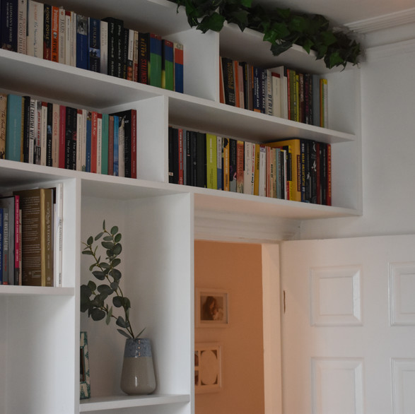 Image of storage cupboards. Wall was blank before new installation- Client in Ealing