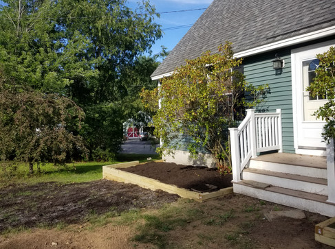 New lawn material and adding compost to new flower garden