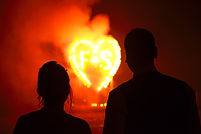 Couple watching fireworks finding passion
