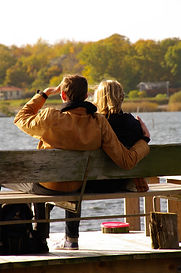 Couple enjoying fall folliage and lake view