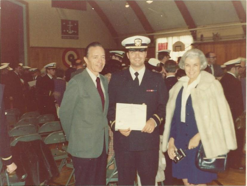 Burr graduating as an Officer with Grandpa and Grandma