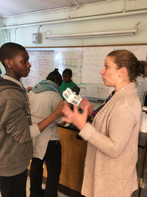 Emily being interviewed by a student