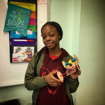 8th Grader with her STEM Project
