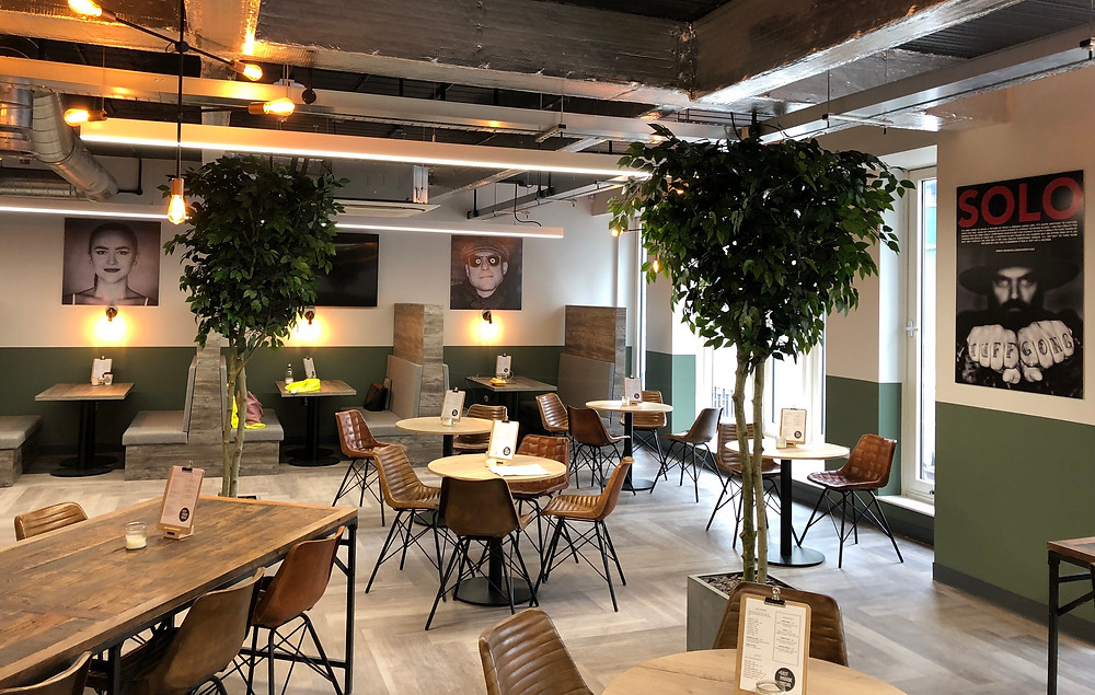 Fire retardant artificial trees for commercial office interiors