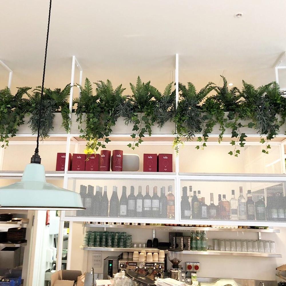 Artificial fire retardant trailing plants for restaurant interior