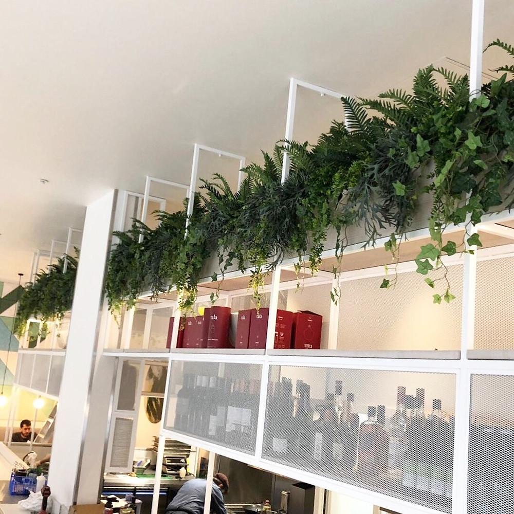 Artificial plants in bar gantry by Arti Green Ltd