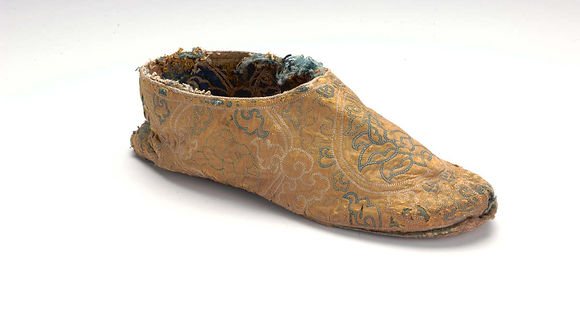 CH-8s Embroidered silk shoe, circa 1500.