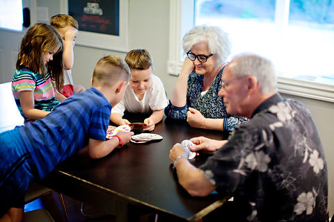 kids-playing-card-games-with-grandparent