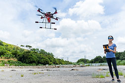 woman-controling-with-drone-GYBD25C.jpg
