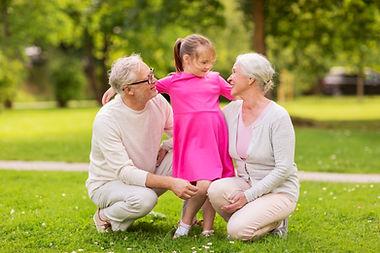 senior-grandparents-and-granddaughter-at