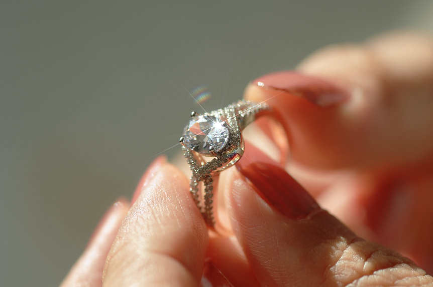 close-up-view-of-a-diamond-ring-and-woma