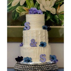 I would never recommend a baker baking their own wedding cake. That being said... I made my own
