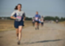woman-in-gray-crew-neck-shirt-running-on