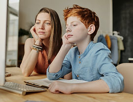 photo-of-woman-and-boy-leaning-on-wooden