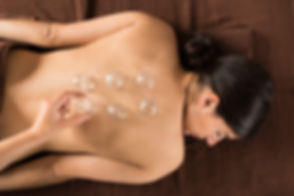 Woman At Spa Receiving Cupping Therapy.j
