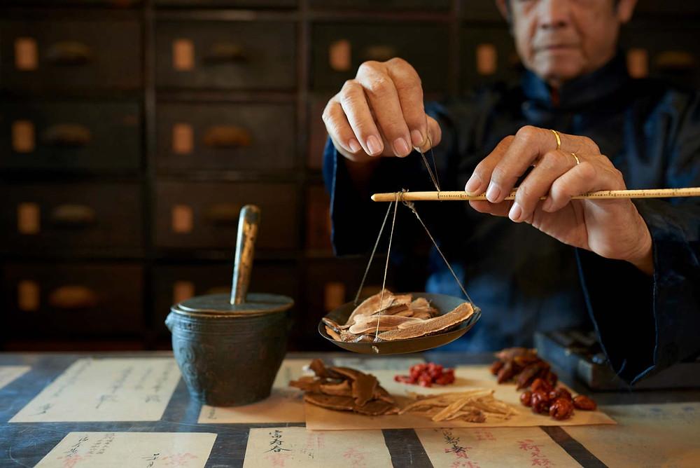 Measuring herbs in an Asian apothecary