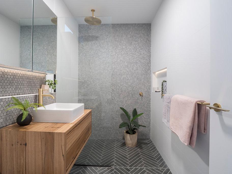 jmb modular builder display port design interior beautiful bathroom penny round tile chevron timber indoor plants brass taps kialla
