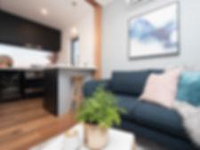 jmb modular builder shepparton port display home blue couch black kitchen brass tap interior prefab construction