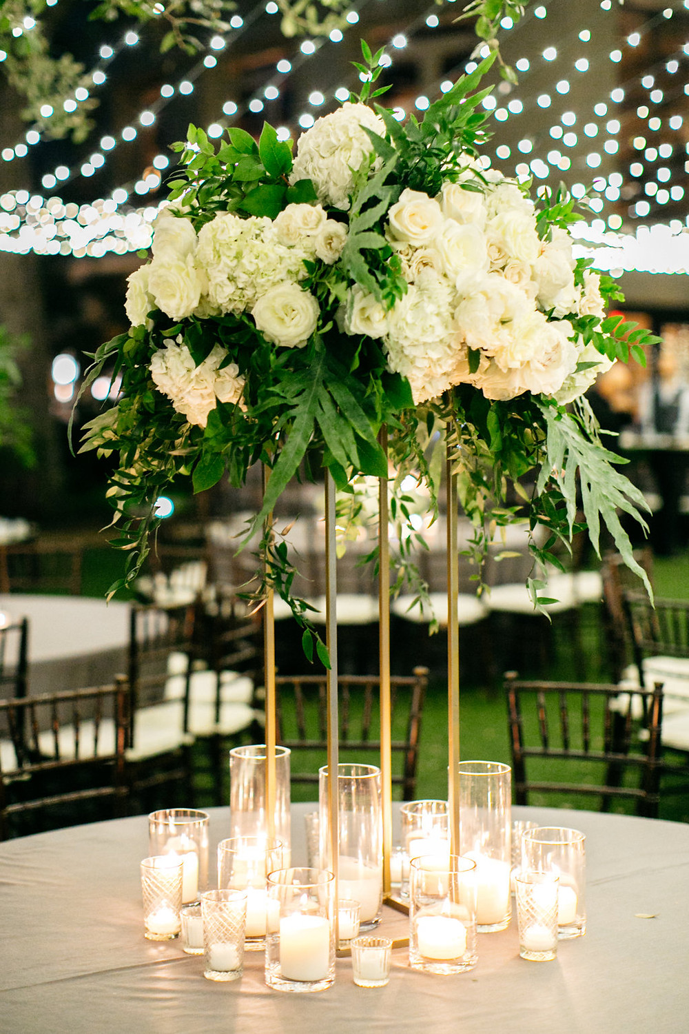 Roses and Hydrangea Tall topiary centerpiece on gold legs with white candles