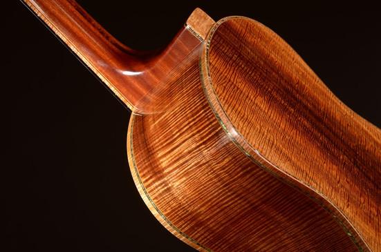 All master grade Koa, multi-scale guitar