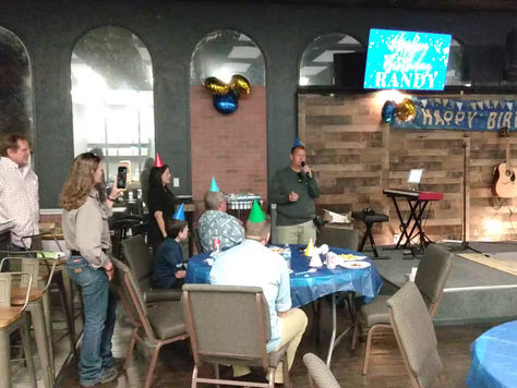 Randy speaking after he sang at his birthday party.