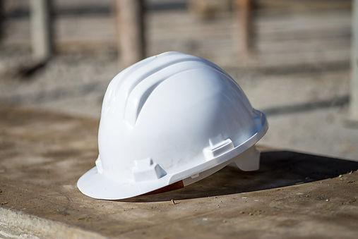 white-construction-helmet-on-the-ground-