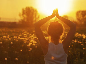 prayer pose arms up in a field.jpg
