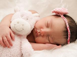 baby-sleeping-with-animal-plush-toy-2797865.jpg
