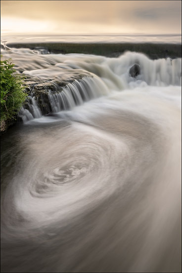 A long exposure photograph of a small waterfall at Parkhill Dam, Galt (Cambridge) Ontario Canada