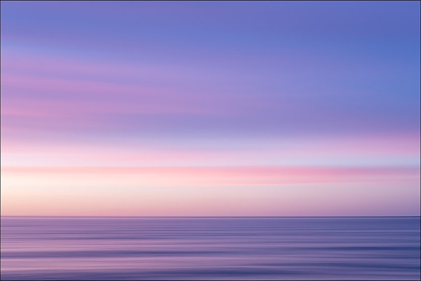 Abstract photograph of sea and sky during a pink and purple sunset