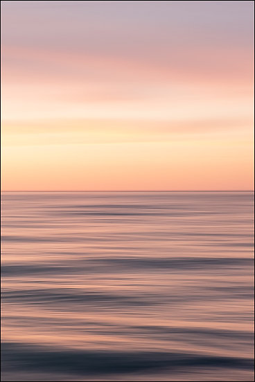 Abstract photograph of an orange horizon over the water at sunset
