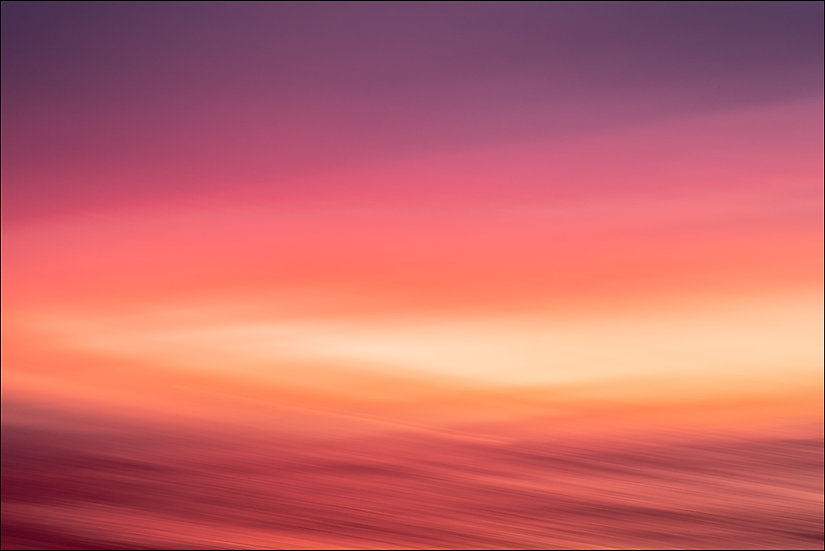 Abstract photograph of an orange and red sky at sunset