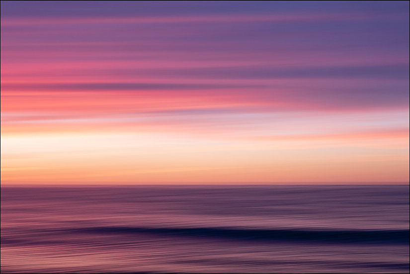 Abstract photograph of a purple horizon over the water at sunset