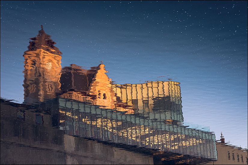 Idea Exchange's Old Post Office reflected in the waters of the Grand River, Galt (Cambridge), Ontario Canada