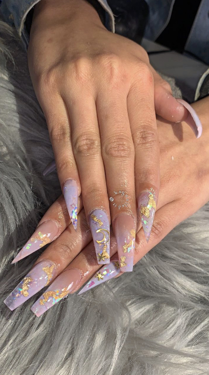 This is a set of long, ballerina shaped acrylics. For a bold touch, add initials or numbers in a gothic font with a solid color underneath.