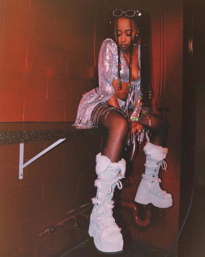 """YBT wore this dazzling, sequin, two piece set by The Ivy Showroom at her concert in Atlanta, GA. YBT was traveling across the nation during her """"The Acrylic Tour"""" with Leikeli47. She's giving us snow princess with the choice of these high-rise, platform, snow boots. ICY"""