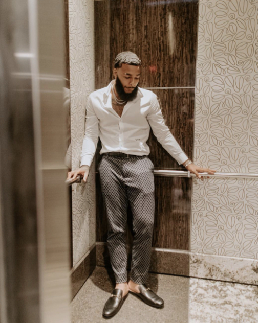 Who doesn't want a man that knows how to dress up? White and black together has always been a classic look. The elements of interest are the pattern present in the pants and the softness of the fabric, which we can tell by how the fabric gently falls on the body.