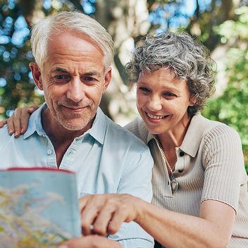 happy-senior-tourist-reading-map-PGPTPEB