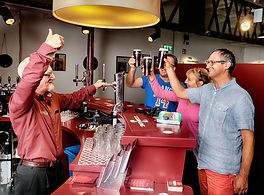 People drink a pint at the Smthwicks Experience