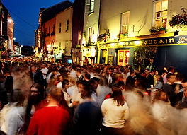 crowds at night on Shop Street in Galway City
