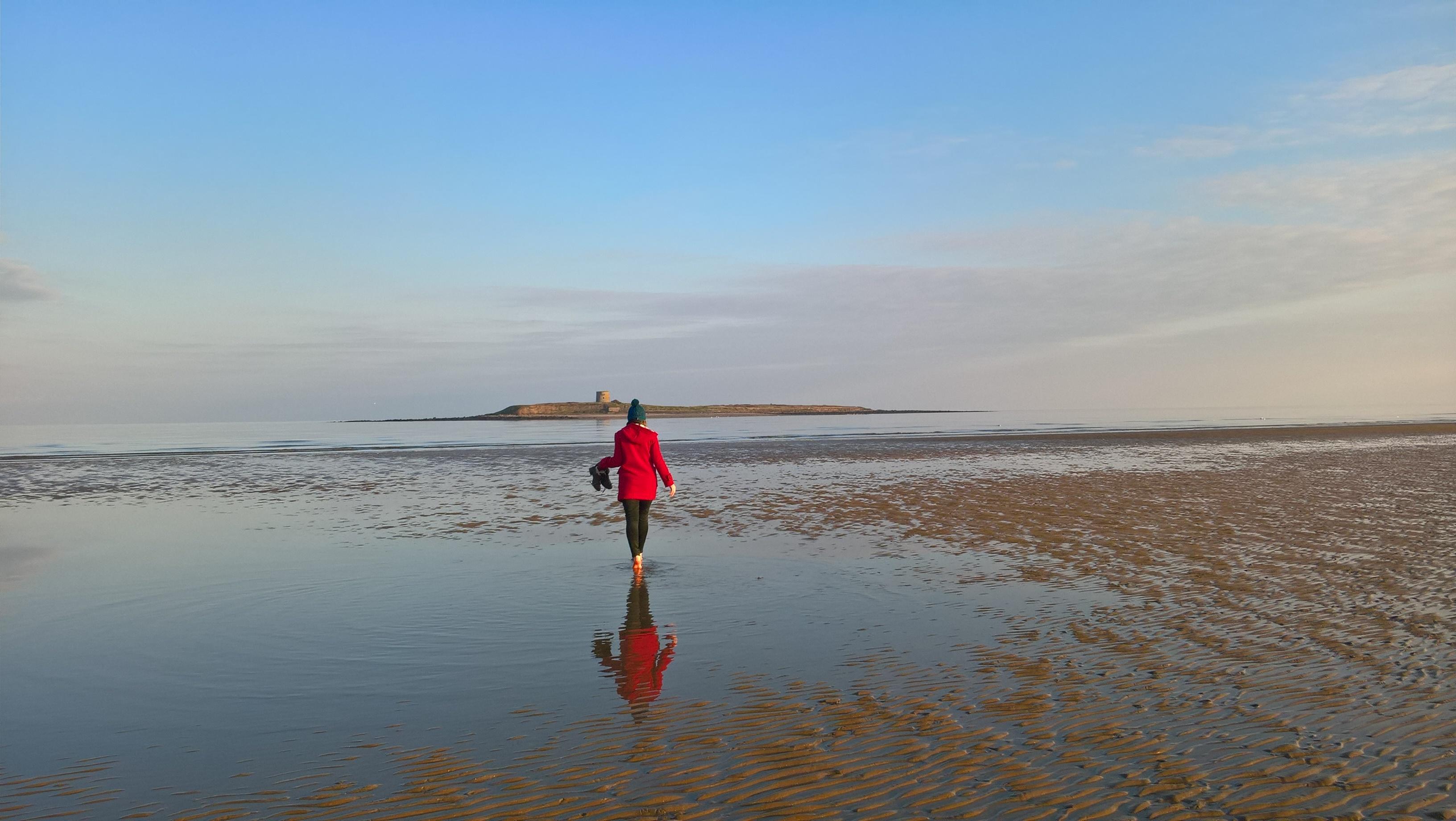 Girls in red walking Skerries beach