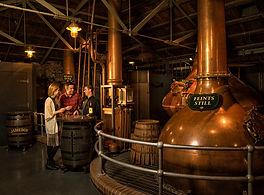 Pot still and visitors at Jameson Distillery Bow St. in Dublin
