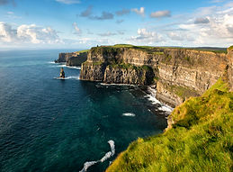 the huge Cliffs of Moher on a calm day