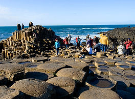 People clamber around the Giant's Causeway